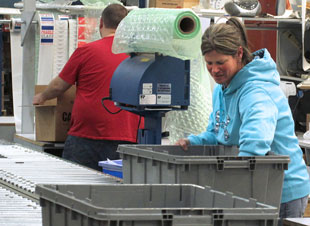 Woman working at our Rock Creek distribution center