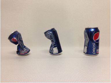 Figure 1  Imploded cans with interior water from left to right at 100° C, 90° C, and 80° C.