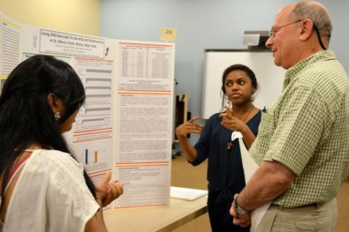 Figure 2   UBP 2012–13 first-place winners Kavita Bhikhi and Hillary Ramirez present their poster to judge Jesse Ausubel, Vice President, Alfred P. Sloan Foundation.